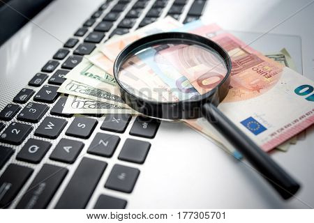 Searching Way To Earn Money On Internet Concept Magnifier And Banknotes On Computer Keyboard