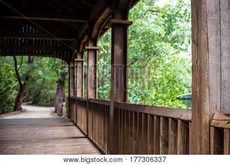 rail of bridge with distant blurred pathway