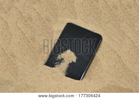 Mobile Phone In Sand.