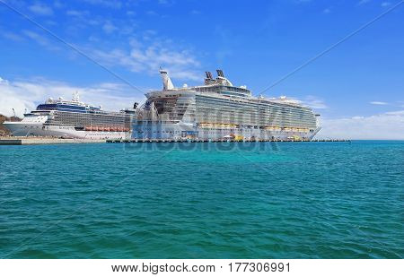 PHILISBURG,ST. MARTEEN - APRIL 16,2015: Cruise ships Celebrity Silhouette and Allure of the Seas, docked at Philisburg, St. Marteen harbor on a clear sunny day.