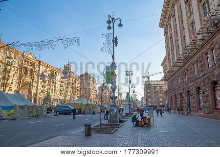 KIEV, UKRAINE - MARCH 22, 2014: People visiting Maidan square and barricades on the Khreshchatyk street, witch still stand because people waiting for the Presidential elections.