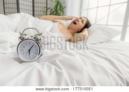 What time is it. Snooze locating in front of yawing female