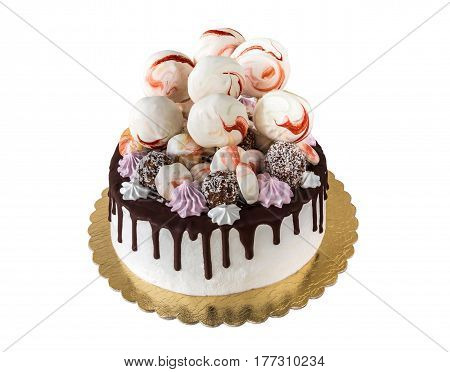 Cream cake with chocolate stains and meringue (kisses) cake pops isolated on white background
