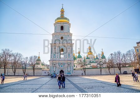 KIEV, UKRAINE - MARCH 22, 2014: People sightseeing Saint Sophia Cathedral tower at Sofiiska square.