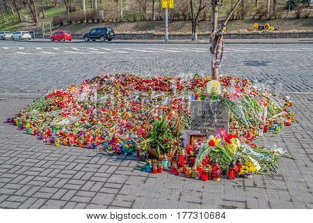 KIEV, UKRAINE - MARCH 22, 2014: Flowers for the dead ahead The International Convention Center.