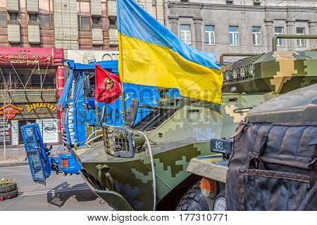 KIEV, UKRAINE - MARCH 22, 2014: Police and military transporter truck still stand at Maidan square with a Ukraine flag on it.