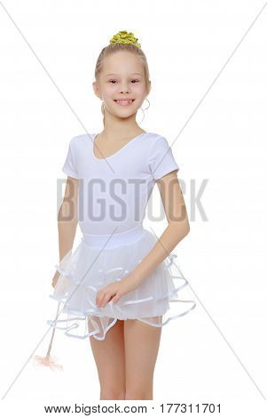 Cheerful little girl gymnast in a white sports dress with a magic wand in hand.Isolated on white background.