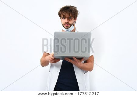 Bearded Caucasian Doctor Or Postgraduate Student With Laptop In Mask