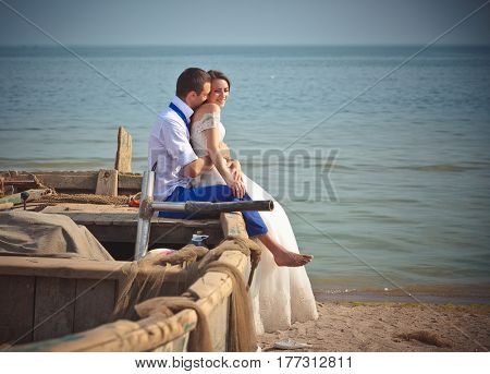 Wedding couple in a boat on the beach