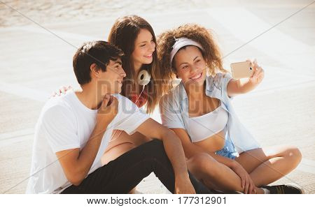 group of teenagers on the street doing selfie