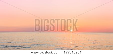 Sun Is Rising On Horizon At Sunset Or Sunrise Over Sea Or Ocean. Tranquil Sea Ocean Waves. Natural Sky Warm Colors. Panoramic View, Panorama.