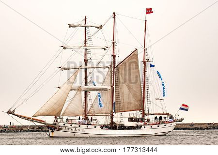 Rostock, Germany - August 2016: Sailing ship Loth Lorien on the baltic sea. Hanse-Sail Warnemuende at port Rostock, Mecklenburg-Vorpommern, Germany. Tall Ship.Yachting and Sailing travel. Cruises and holidays