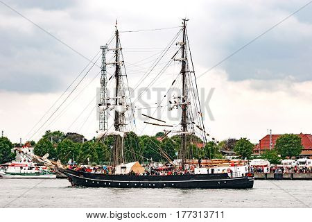 Rostock, Germany - August 2016: Sailing ship Roald Amundsen on the baltic sea. Hanse-Sail Warnemuende at port Rostock, Mecklenburg-Vorpommern, Germany. Tall Ship.Yachting and Sailing travel. Cruises and holidays