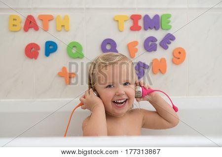 Smily Little Girl Having Fun In Bath.