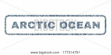 Arctic Ocean text textile seal stamp watermark. Blue jeans fabric vectorized texture. Vector tag inside rounded rectangular banner. Rubber sign with fiber textile structure.