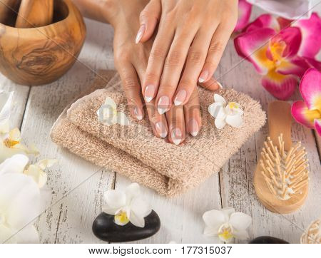 Woman with beautiful manicured nails in spa.