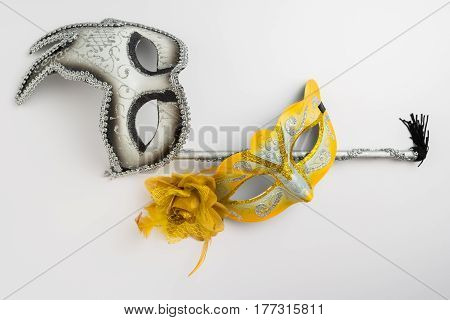 Two colorful carnival masks on white background.