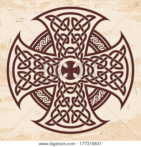 Celtic national ornament in the shape of a cross. Brown drawing with aging effect on a beige background.