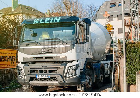 STRASBOURG FRANCE - MAR 13 2017: Front view of Volvo FMX truck with Liebherr cement mixer instalation working at the construction site on tiny French street