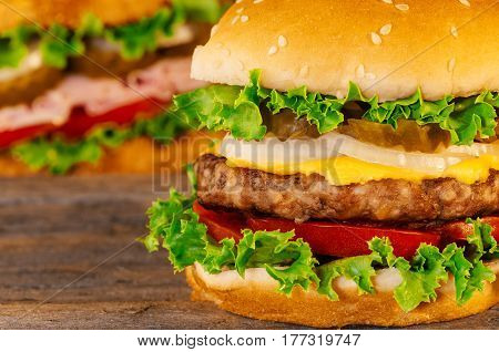 Closeup Of Home Made Burgers Wooden Background