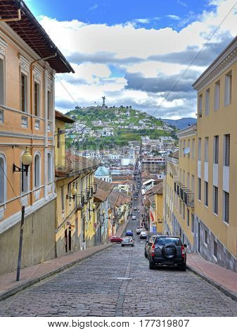 View of downtown Quito with the Panecillo hill in the background