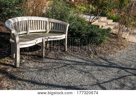 Wood bench and waking paths in a garden
