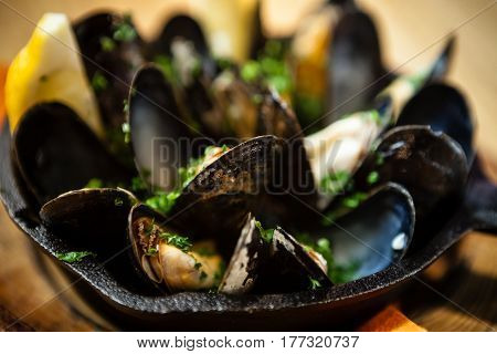 Steamed mussels in white wine sauce served in a pan