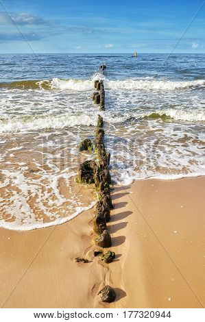 Old Wooden Breakwater On A Beach, Summer Background