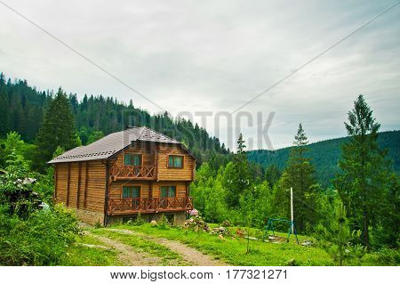 Two-storey wooden house on the of the mountain. Ukraine Carpathians