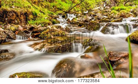 view on dreamy waterfall in Scotland landscape