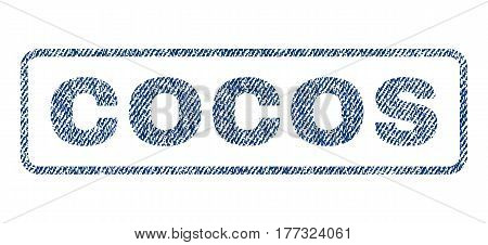 Cocos text textile seal stamp watermark. Blue jeans fabric vectorized texture. Vector caption inside rounded rectangular shape. Rubber sign with fiber textile structure.