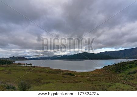 Australian rural landscape with lake on overcast day