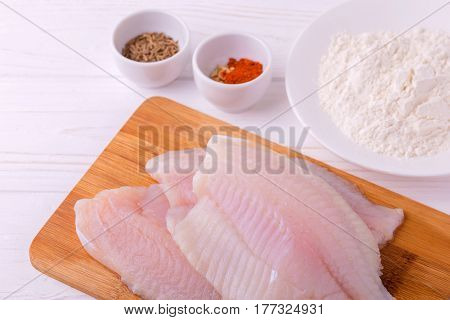 Ingridients For Fried Fish Tilapia. Raw Fillet, Fleur, Cumin