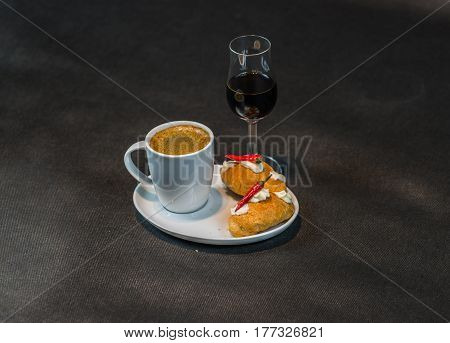 Black Coffee In White Cup, With Croissants On Saucer, Liqueur, Peppers