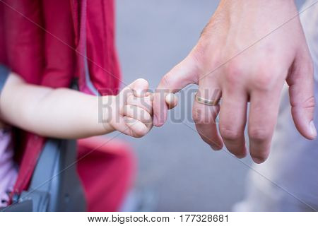 Close up of father holding his daughter handfamily time.