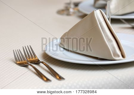 table setting forks on a table in the restaurant