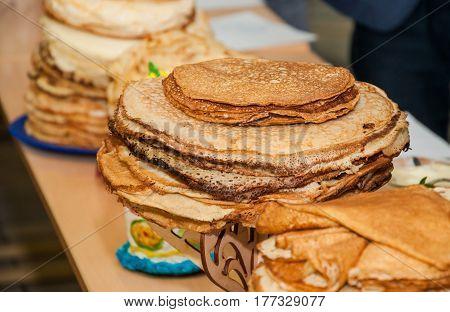 Different pancakes while celebrating  Russian Shrovetide (pancake week)