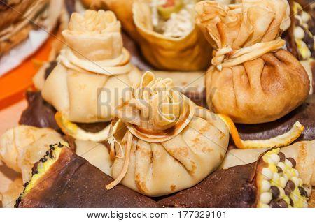 Stuffed pancakes, rolled in the form of sacks Russian Shrovetide (pancake week)