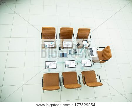 top view - chairs and Desk with documents and laptop for negotiations with business partners.the photo is a blank space for your text