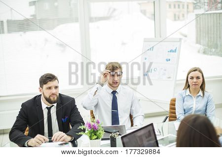 experienced crisis Manager and business team conducted a working meeting in a modern office.the photo has a empty space for your text