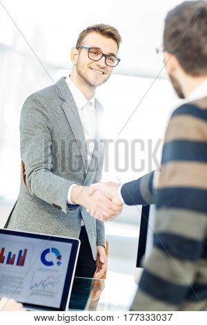 closeup - the lawyer and the client, shake hands after signing the financing contract.