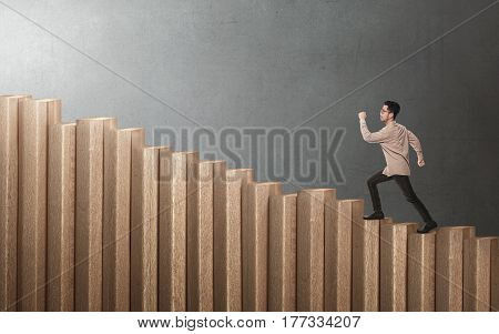 Handsome Asian Businessman Walking Up The Stairs