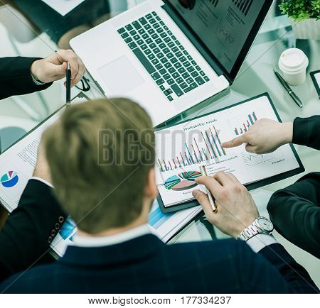 business team at the workplace makes the analysis of marketing reports.