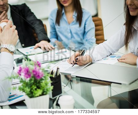 business team makes an analysis of the conditions of the new contract in the workplace in the office.