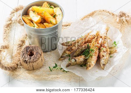 Tasty Smelt Fish And Chips With Herbs And Salt
