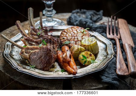 Hot Grilled Ribs Of Lamb On The Burnt Black Table