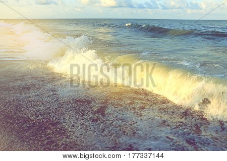 wave of the sea on the beach with sunlight in South of Thailand