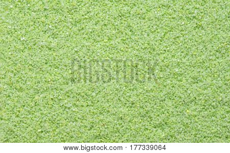 Green sand texture. Green sand. Background from fine sand. Green sand background