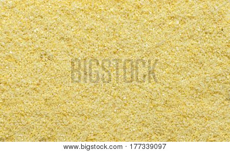 Yellow sand texture. Yellow sand. Background from fine sand. Yellow sand background