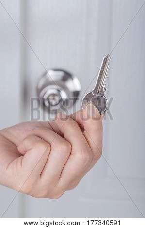 Key In Hand With Door Knob Background